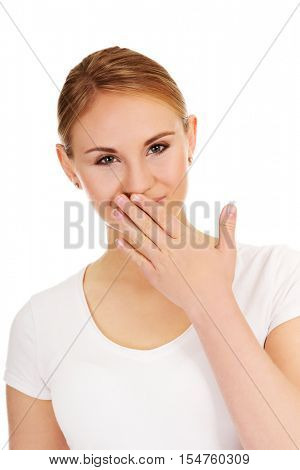 Giggles young woman covering her mouth with hand