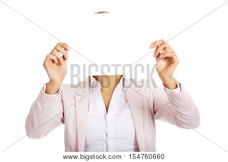 Business woman covering face with blank paper sheet