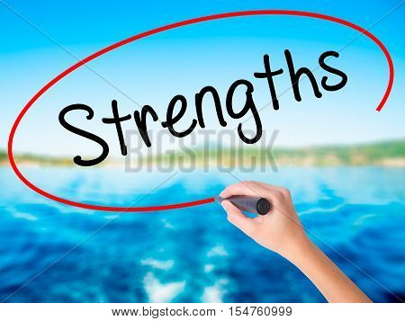 Woman Hand Writing Strengths With A Marker Over Transparent Board.