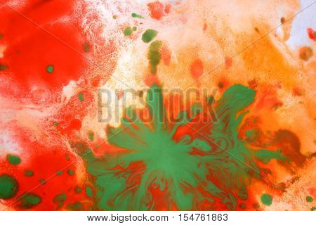 Orange red green blots splashes drips stains on a white background. Abstract pattern