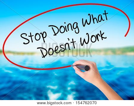 Woman Hand Writing Stop Doing What Doesn't Work With A Marker Over Transparent Board