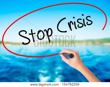 Woman Hand Writing Stop Crisis With A Marker Over Transparent Board