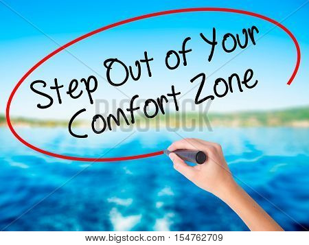 Woman Hand Writing  Step Out Of Your Comfort Zone With A Marker Over Transparent Board.