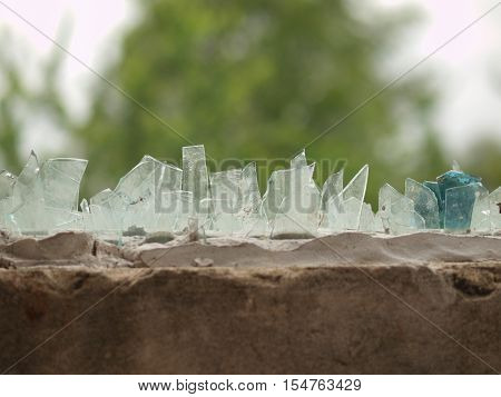 GLASS PIECES ON THE HOUSE FENCE FOR PROTECTION OF INTRUDERS