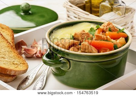 Turkey goulash stewed with vegetables and mashed potatoes.