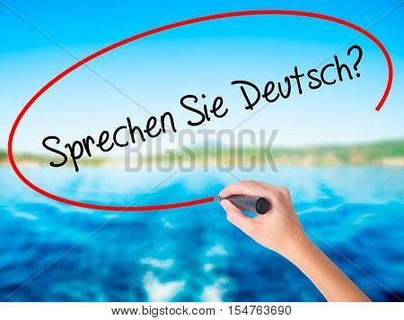 "Woman Hand Writing ""sprechen Sie Deutsch?"" (in German - Do You Speak German?) With A Marke"