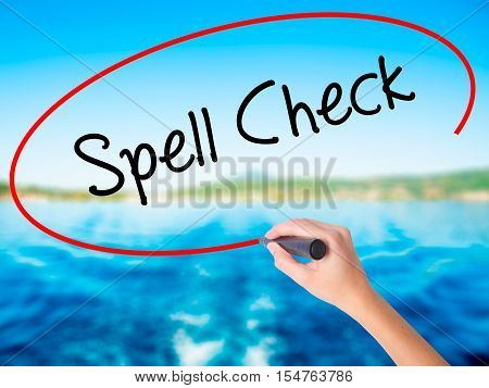 Woman Hand Writing Spell Check  With A Marker Over Transparent Board