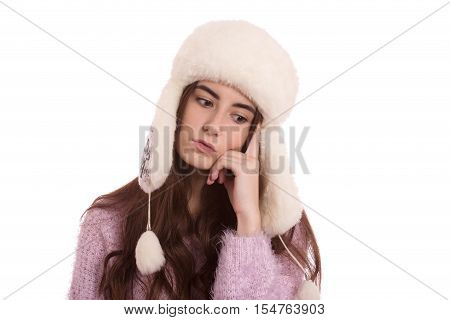 serious girl thinker in winter hat isolated on white background