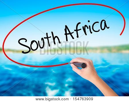 Woman Hand Writing South Africa With A Marker Over Transparent Board
