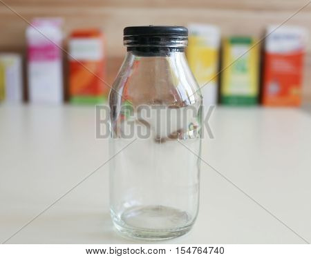 Jar with airtight lid for storing pills and ointments.
