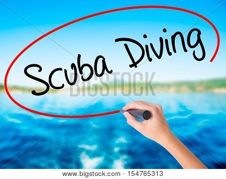 Woman Hand Writing Scuba Diving With A Marker Over Transparent Board