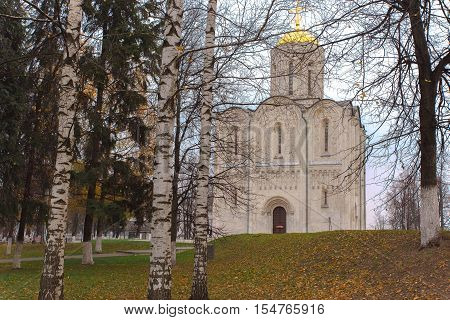 Ancient Cathedral of St. Demetrius of the twelfth century in the medieval capital of Russia - the city of Vladimir, in the autumn afternoon