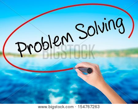 Woman Hand Writing Problem Solving With A Marker Over Transparent Board