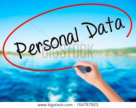Woman Hand Writing Personal Data  With A Marker Over Transparent Board