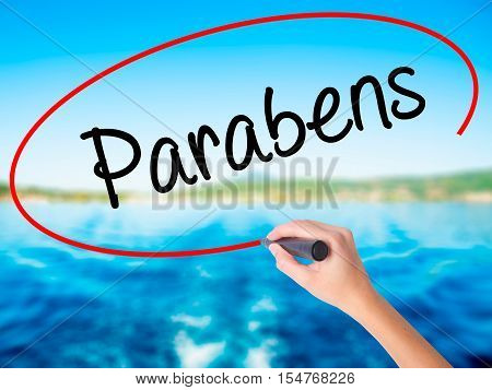 Woman Hand Writing Parabens (happy Birthday In Portuguese) With A Marker Over Transparent Board