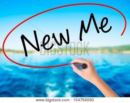Woman Hand Writing New Me With A Marker Over Transparent Board