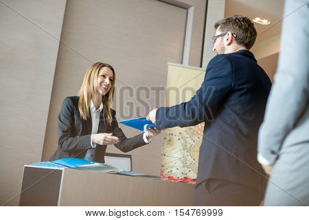 Business man checking in at a convention