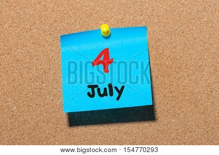 July 4th. Day 4 of month, color sticker calendar on notice board. Summer time. Close up.
