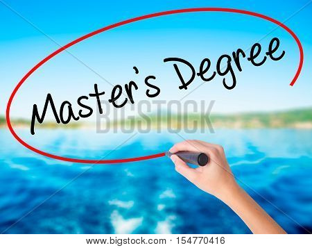 Woman Hand Writing Master's Degree With A Marker Over Transparent Board.