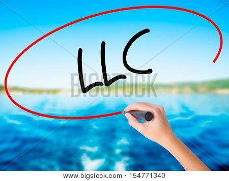 Woman Hand Writing  Llc (limited Liability Company)  With A Marker Over Transparent Board