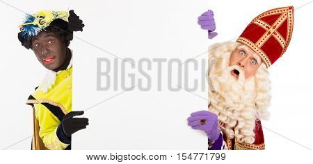 Sinterklaas and black pete with blank paper. isolated on white background. Dutch character of Santa Claus