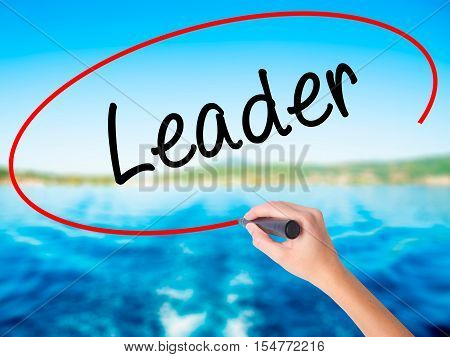 Woman Hand Writing Leader With A Marker Over Transparent Board