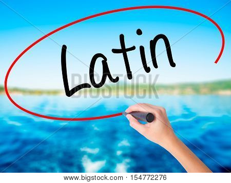 Woman Hand Writing Latin With A Marker Over Transparent Board.