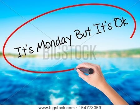 Woman Hand Writing It's Monday But It's Ok With A Marker Over Transparent Board