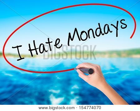 Woman Hand Writing I Hate Mondays With A Marker Over Transparent Board