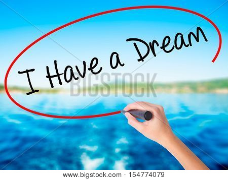 Woman Hand Writing I Have A Dream With A Marker Over Transparent Board