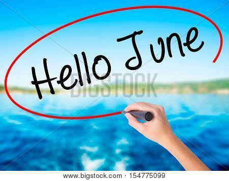 Woman Hand Writing Hello June  With A Marker Over Transparent Board