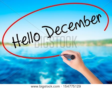 Woman Hand Writing Hello December No With A Marker Over Transparent Board