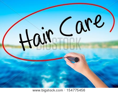Woman Hand Writing  Hair Care With A Marker Over Transparent Board