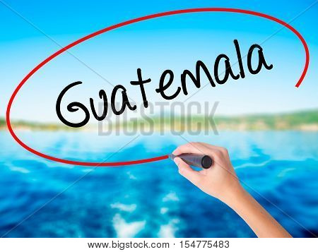 Woman Hand Writing Guatemala  With A Marker Over Transparent Board