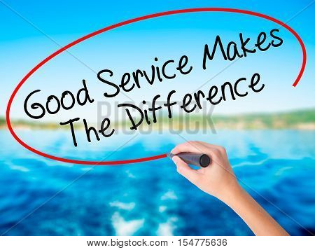 Woman Hand Writing Good Service Makes The Difference With A Marker Over Transparent Board