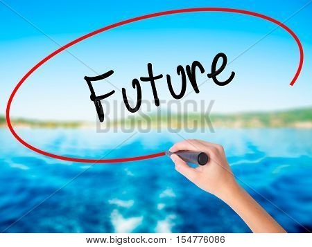 Woman Hand Writing Future  With A Marker Over Transparent Board