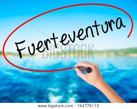 Woman Hand Writing Fuerteventura With A Marker Over Transparent Board