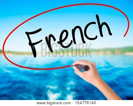Woman Hand Writing French With A Marker Over Transparent Board