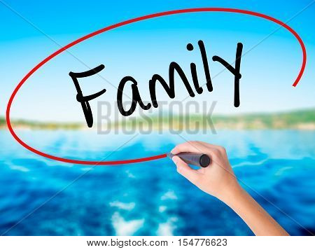 Woman Hand Writing Family With A Marker Over Transparent Board
