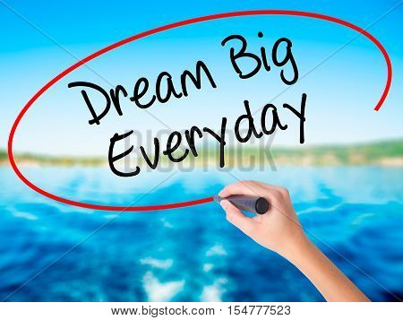 Woman Hand Writing Dream Big Everyday With A Marker Over Transparent Board