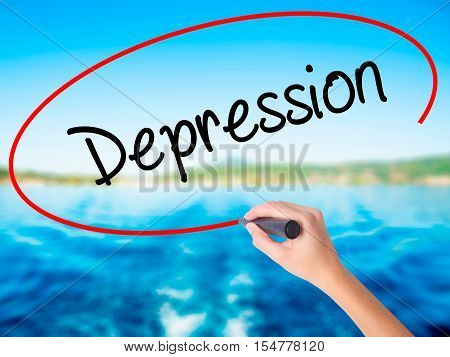 Woman Hand Writing Depression  With A Marker Over Transparent Board
