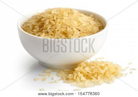 Bowl Of Long Grain Parboiled Rice Isolated On White. Spilled Rice.