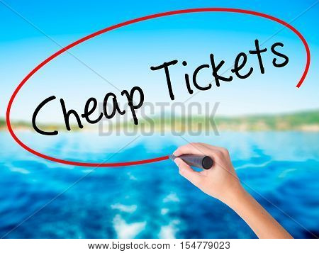 Woman Hand Writing Cheap Tickets With A Marker Over Transparent Board