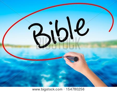 Woman Hand Writing Bible With A Marker Over Transparent Board