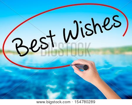 Woman Hand Writing Best Wishes  With A Marker Over Transparent Board