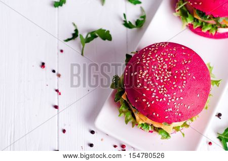 Tasty Burger With, Sausage, Lettuce And Mayonnaise Served On A White Plate