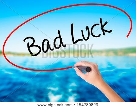 Woman Hand Writing Bad Luck With A Marker Over Transparent Board