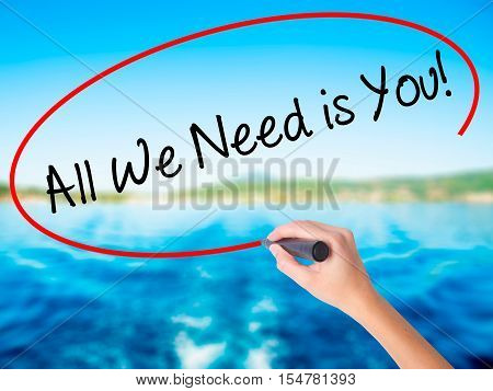 Woman Hand Writing  All We Need Is You!  With A Marker Over Transparent Board