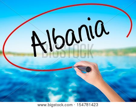 Woman Hand Writing Albania  With A Marker Over Transparent Board