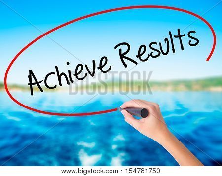 Woman Hand Writing  Achieve Results With A Marker Over Transparent Board.
